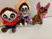 A set of plush characters from the movie Coco, big